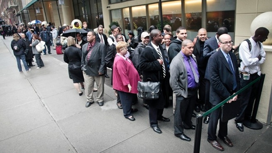 Job seekers wait in line to see employers at a National Career Fairs' job fair in New York.