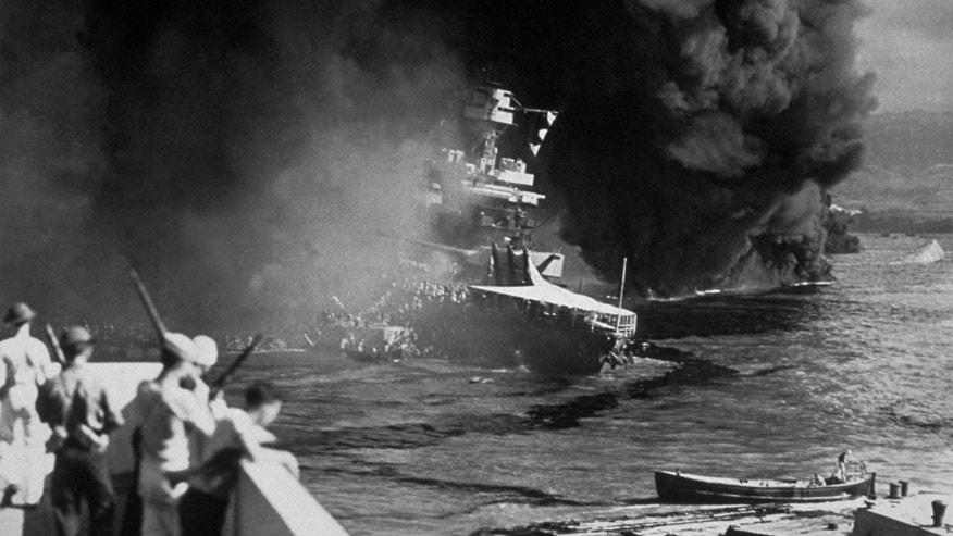 10th December 1941: The USS California on fire in Pearl Harbor (Pearl Harbor) after the Japanese attack. (Photo by Fox Photos/Getty Images)