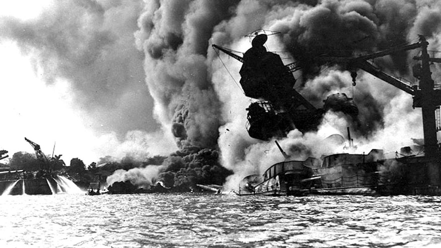 The USS Arizona burns during the bombing of Pearl Harbor, December 7, 1941 in Hawaii. (Photo courtesy of U.S. Navy/Newsmakers)