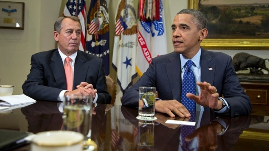 Nov. 16, 2012: President Barack Obama, accompanied by House Speaker John Boehner of Ohio, speaks to reporters in the Roosevelt Room of the White House in Washington.