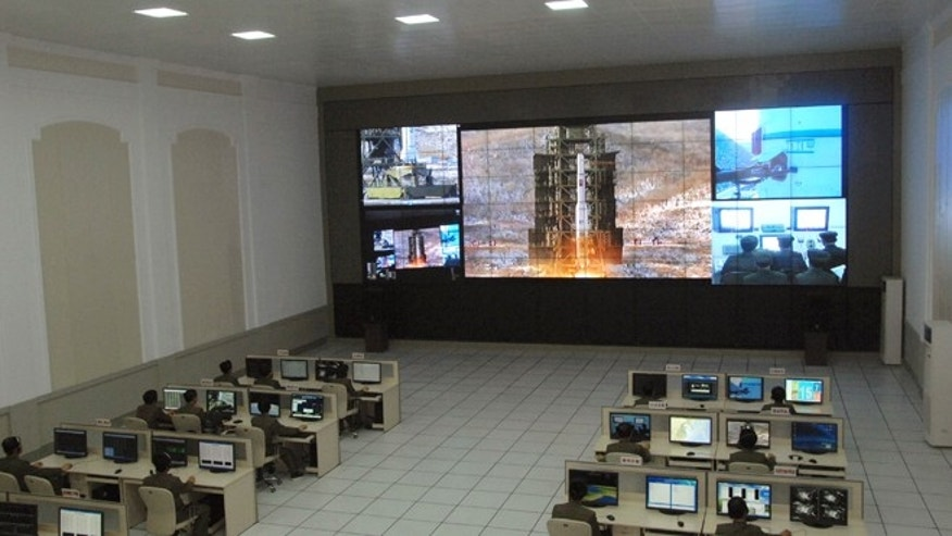 Dec. 12, 2012: Scientists and technicians at the General Satellite Control and Command Center on the outskirts of Pyongyang watch the launch of the Unha-3 rocket.