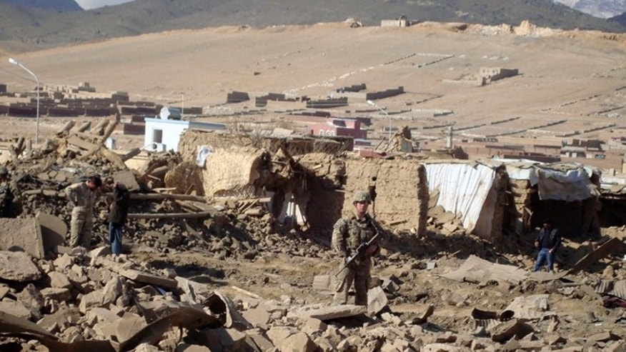 Nov. 23, 2012: A U.S. soldier stands guard at the site of suicide attack in Wardak Province of Kabul Afghanistan.