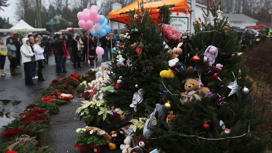 NEWTOWN, CT - DECEMBER 16: Stuffed animals decorate Christmas trees donated in memory of those killed at the Sandy Hook School December 16, 2012 in Newtown, Connecticut