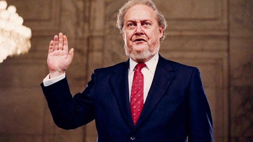 In this Sept. 15, 1987 file photo, Judge Robert Bork, nominated by President Reagan to be an associate justice of the Supreme Court, is sworn before the Senate Judiciary Committee on Capitol Hill at his confirmation hearing.