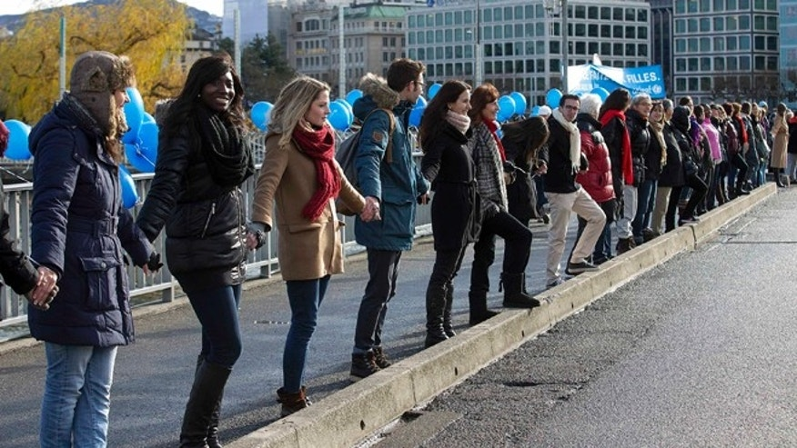 "Dec. 10, 2012: Called by UNICEF the demonstrators form a human chain on the occasion of the International Human Rights Day on the bridge ""Pont des Bergues"" in Geneva, Switzerland."