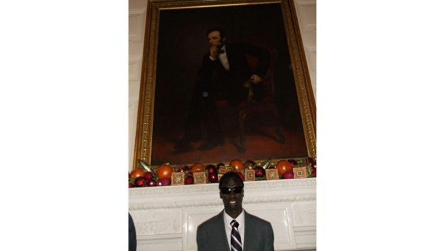 Keer Aleu next to the photo of Abraham Lincoln at the White House, December 2012.