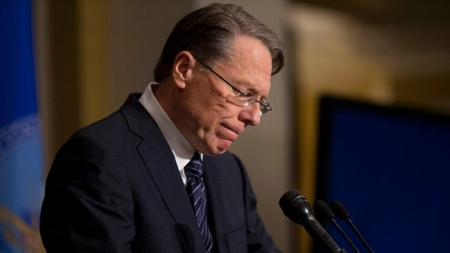 FILE: Dec. 21, 2012: National Rifle Association CEO Wayne LaPierre pauses as he makes a statement during a news conference in Washington.