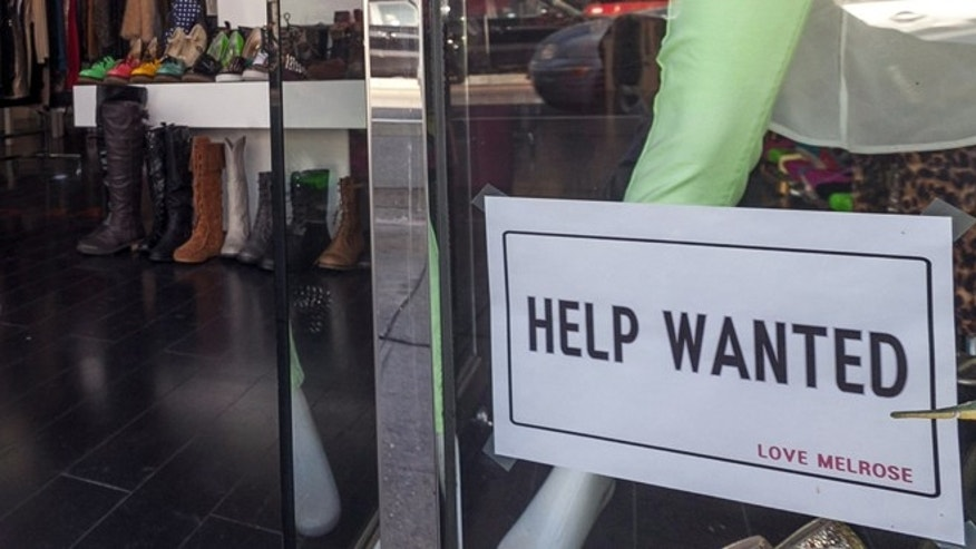 Dec. 7, 2012: A help wanted sign is posted on the front window of a clothing boutique in Los Angeles.