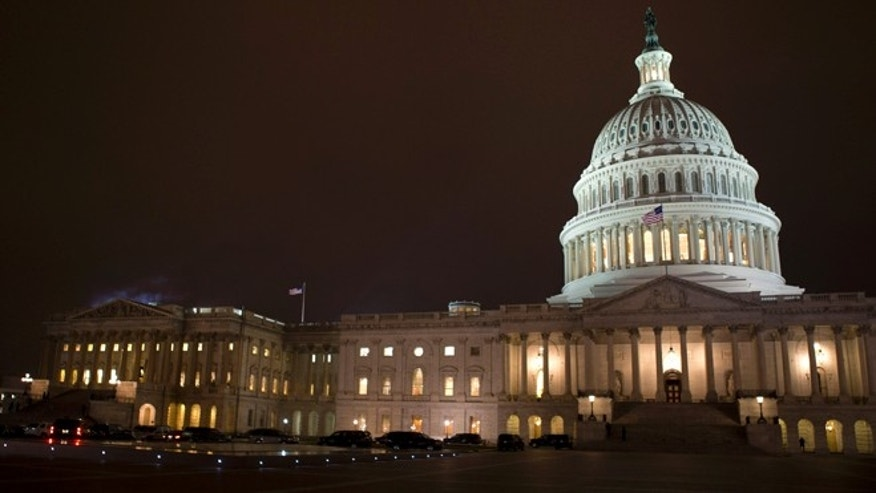 "Jan. 1, 2013: The lights of the U.S. Capitol remain lit into the night as the House continues to work on the""fiscal cliff"" legislation proposed by the Senate."
