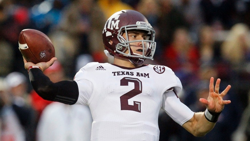 Oct. 6, 2012: Texas A&M quarterback Johnny Manziel throws a pass in the first quarter of an NCAA college football game against Mississippi in Oxford, Miss.