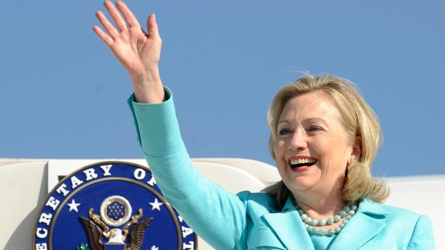 FILE: In this June 10, 2011 file photo, Secretary of State Hillary Rodham Clinton waves as the arrives at Lusaka International Airport in Lusaka, Zambia.