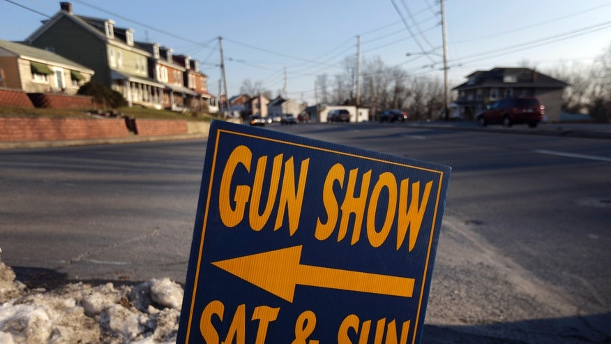 Jan. 4, 2012: A sign is posted for an upcoming gun show in Leesport, Pa.