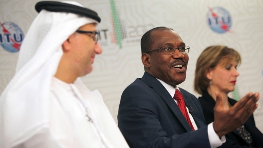 Dec. 14, 2012: Hamdoun Toure, Secretary General of International Telecommunication Union, ITU, middle, speaks to journalists on the final day of the World Conference on International Telecommunications in Dubai, United Arab Emirates.
