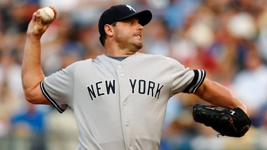 July 23, 2007: In this file photo, New York Yankees starting pitcher Roger Clemens throws against Kansas City Royals' David DeJesus in the first inning of a baseball game in Kansas City, Mo.