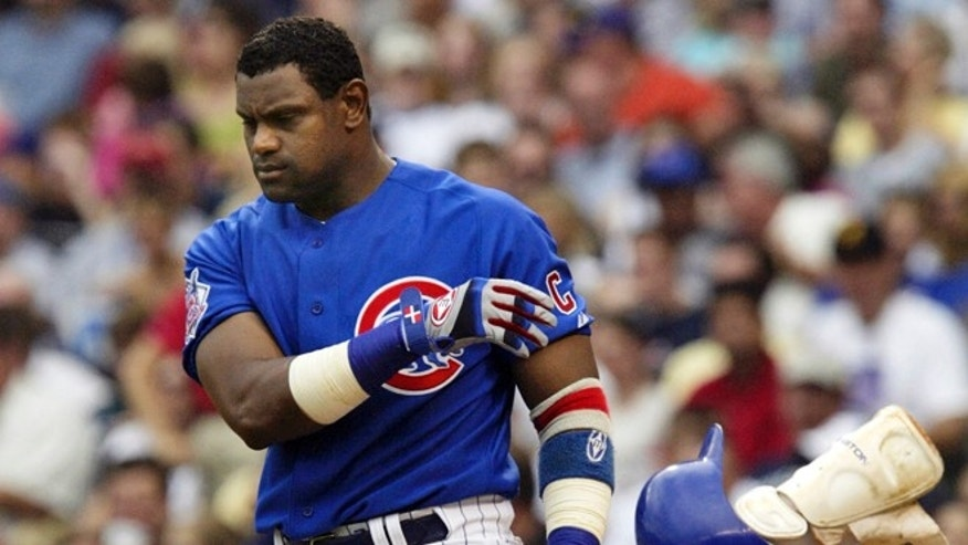 June 18, 2004: In this file photo, Chicago Cubs' Sammy Sosa tosses his helmet and shin guard after striking out to end the sixth inning against the Oakland Athletics during a baseball game in Chicago.