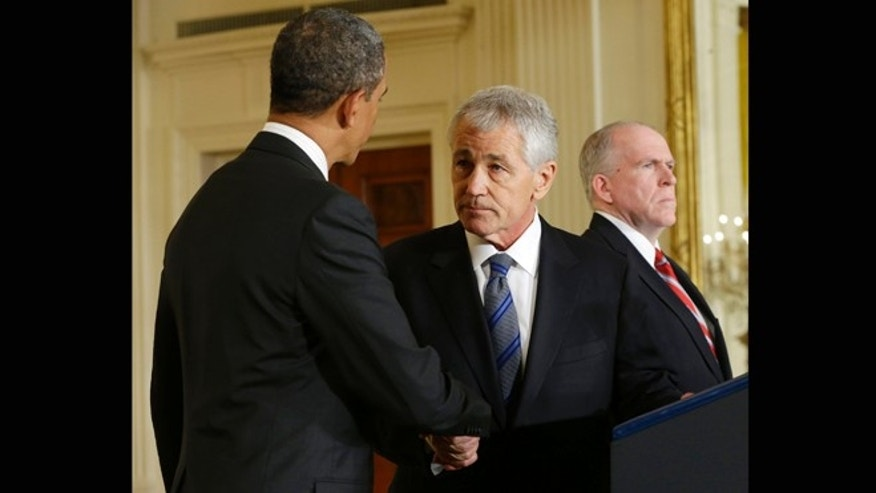 Jan. 7, 2013: President Barack Obama shakes hands with choice for Defense Secretary, former Nebraska Sen. Chuck Hagel, center, after announcing Hagel's nomination in the East Room of the White House in Washington.