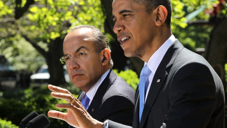 WASHINGTON, DC - APRIL 02:  U.S. President Barack Obama (R) and Mexican President Felipe Calderon (L) participate in a joint press conference in the Rose Garden of the White House April 2, 2012 in Washington, DC. Obama hosted his counterparts from Canada and Mexico for the North American Leaders' Summit (NALS) with talks on cooperation among the three countries, North American's role in the Americas, and as well as other global economic, political, and security issues, according to a White House news release.  (Photo by Alex Wong/Getty Images)