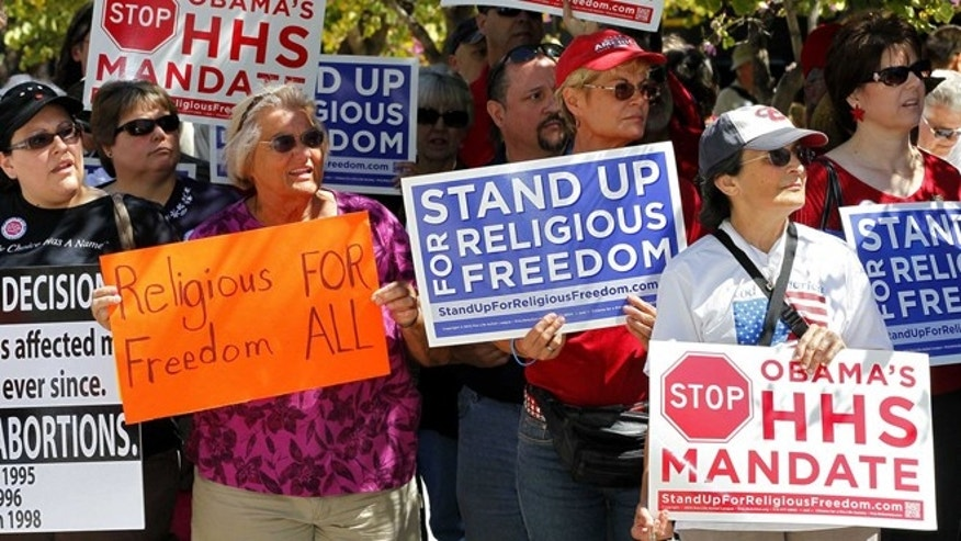 March 23, 2012: Protesters stand outside the Sandra Day O'Connor Federal Courthouse in Phoenix during the Stand Up For Religious Freedom Rally.