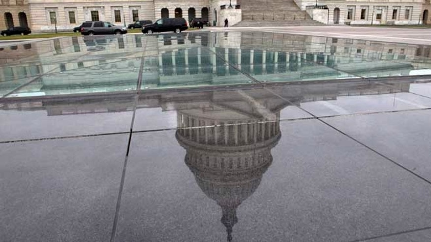 Jan. 1, 2013: The dome of the Capitol is reflected in a skylight of the Capitol Visitor's Center in Washington.