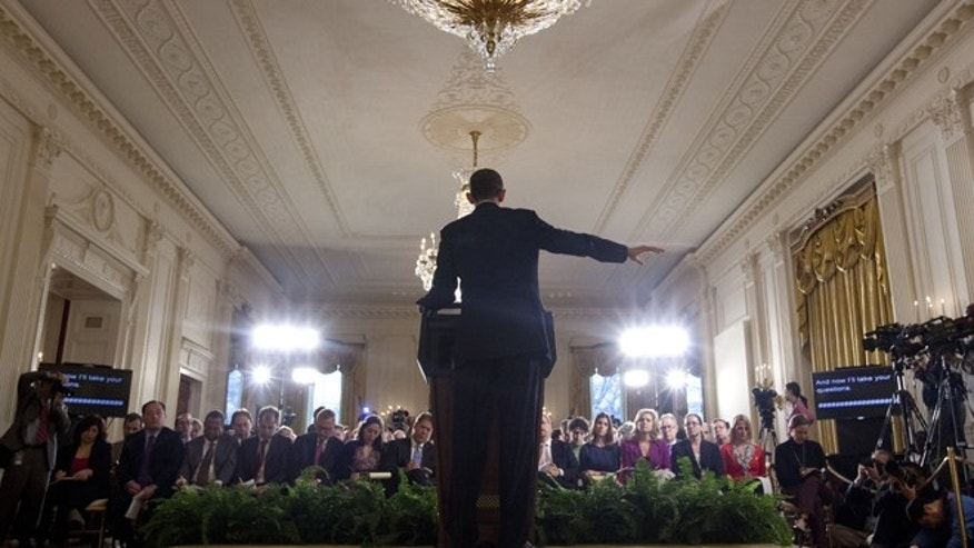 Jan. 14, 2013: President Barack Obama gestures during the final news conference of his first term.