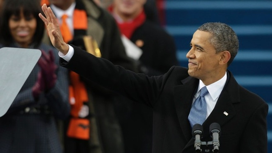 Jan. 21, 2013: President Obama waves after his ceremonial swearing-in at the U.S. Capitol during the 57th Presidential Inauguration in Washington.