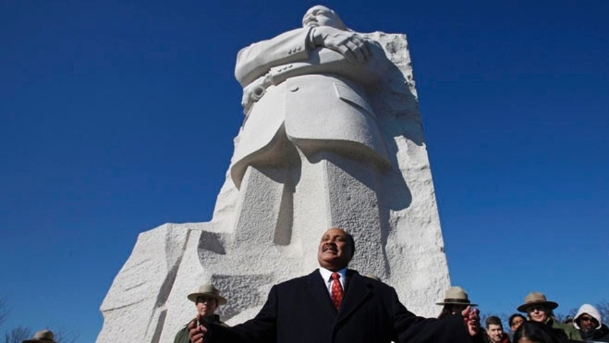 Jan. 15, 2012: Martin Luther King III, center, the son of civil rights leader Martin Luther King Jr., speaks during a ceremony at the Martin Luther King Jr. Memorial, in Washington.