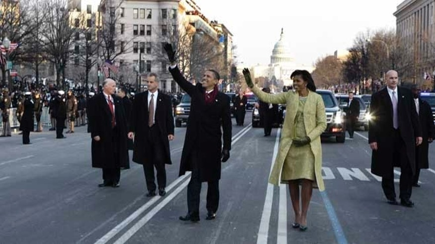 FILE - This Jan. 20, 2009 file-pool photo shows President Barack Obama and first lady Michelle Obama waving as they walk down Pennsylvania Avenue en route to the White House from the Capitol in Washington.
