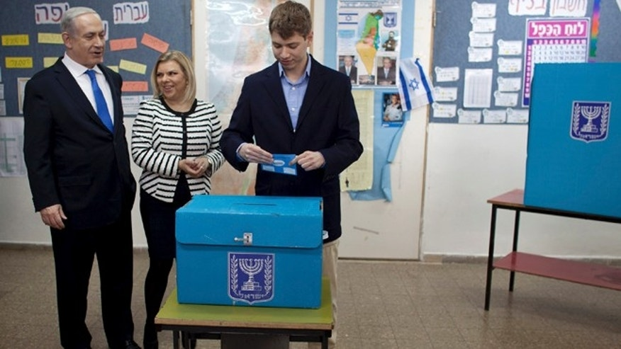 Jan. 22, 2013: Yair Netanyahu, the son of Israeli Prime Minister Benjamin Netanyahu, left, casts his ballot together with his parents at a polling station in Jerusalem.