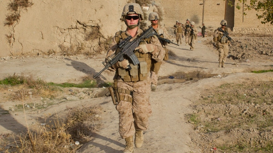 Lance Corporal Kristi Baker,21, US Marine with the FET (Female Engagement Team) 1st Battalion 8th Marines, Regimental Combat team II patrols with other Marines on November 20, 2010 in Musa Qala, Afghanistan.