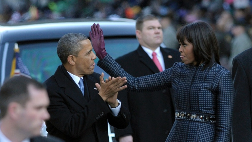 President Obama and first lady Michelle Obama walk in the Inaugural Parade.