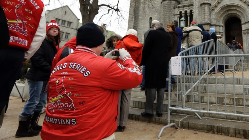 Dave Ebert takes a photo of the line of people as he waits along with them outside Cathedral Basilica of Saint Louis to pay their respects during the public visitation for former St. Louis Cardinals baseball player Stan Musial, Thursday, Jan. 24, 2013, in St. Louis. Musial, one of baseball's greatest hitters and a Hall of Famer with the Cardinals for more than two decades, died Saturday, Jan. 19, 2013. He was 92. (AP Photo/Jeff Roberson)