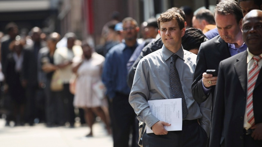 NEW YORK, NY - JUNE 11:  Applicants wait to enter a job fair on June 11, 2012 in New York City. Some 400 people arrived early for the event held by National Career Fairs, and up to 1,000 people were expected by the end of the day.  (Photo by John Moore/Getty Images)