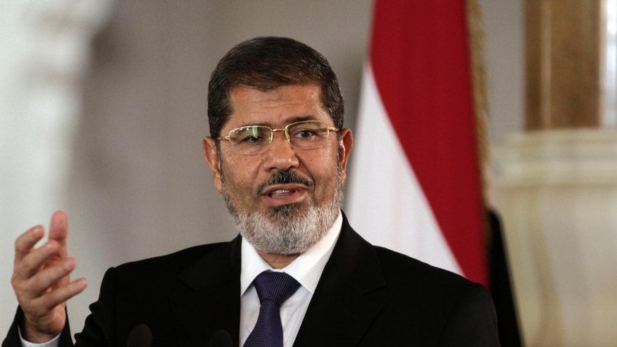 FILE - In this July 13, 2012 file photo, Egyptian President Mohammed Morsi speaks to reporters at the Presidential palace in Cairo. President Barack Obama begins his second term straining to maintain a good relationship with Egypt, an important U.S. ally whose president is a conservative Islamist walking a fine line between acting as a moderate peace broker and keeping his Muslim Brotherhood party happy with anti-American rhetoric. The White House last summer had hoped to smooth over some of the traditional tensions between Washington and the Brotherhood, a party rooted in opposition to Israel and the U.S., when Egypt overthrew dictator Hosni Mubarak and picked Morsi as its first democratically-elected leader. (AP Photo/Maya Alleruzzo, File)