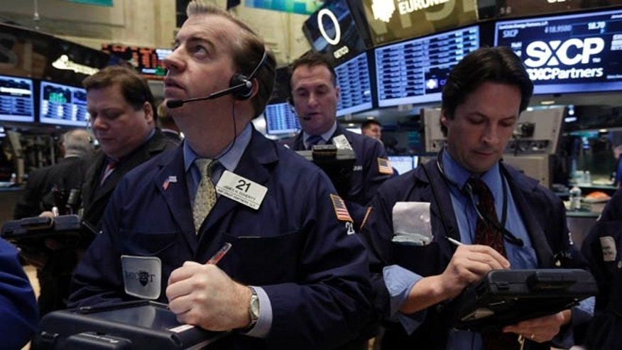 Jan. 23, 2013: James Doherty, foreground left, works with fellow traders on the floor of the New York Stock Exchange.