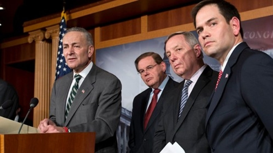 A bipartisan group of leading senators announce that they have reached agreement on the principles of sweeping legislation to rewrite the nation's immigration laws, during a news conference at the Capitol in Washington, Monday, Jan. 28, 2013. From left are Sen. Charles Schumer, D-N.Y., Sen. Robert Menendez, D-N.J., Sen. Dick Durbin, D-Ill., and Sen. Marco Rubio, R-Fla. The deal covers border security, guest workers and employer verification, as well as a path to citizenship for the 11 million illegal immigrants already in this country.  (AP Photo/J. Scott Applewhite)