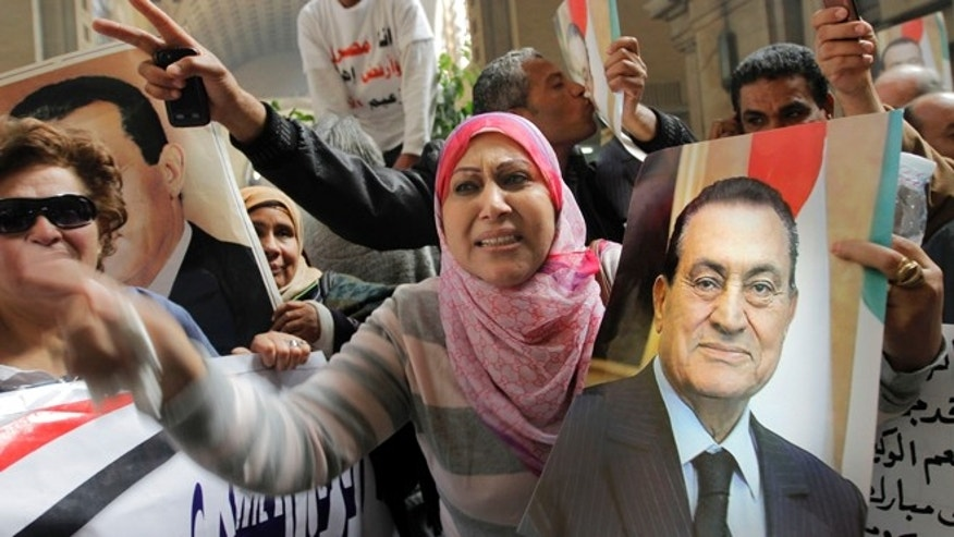 Jan. 13, 2013: Egyptian supporters of ousted former President Hosni Mubarak celebrate an appeal granted by a court.
