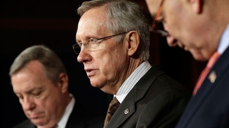 Jan. 31, 2013: Senate Majority Harry Reid, D-Nev., center, with Senate Majority Whip Sen. Dick Durbin, D-Ill., left, and Sen. Chuck Schumer, D-NY., right, answer question regarding immigration reform on Capitol Hill in Washington.