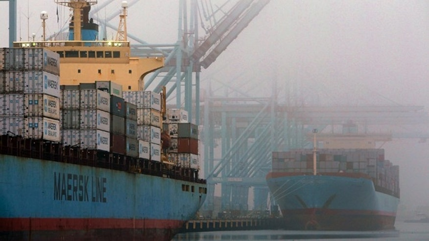 Dec. 5, 2012: Containers are unloaded from cargo ships at  the Port of Los Angeles.