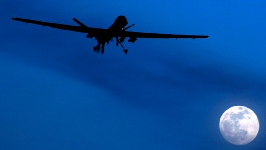 Jan. 31, 2010: An unmanned U.S. Predator drone flies over Kandahar Air Field, southern Afghanistan, on a moon-lit night.