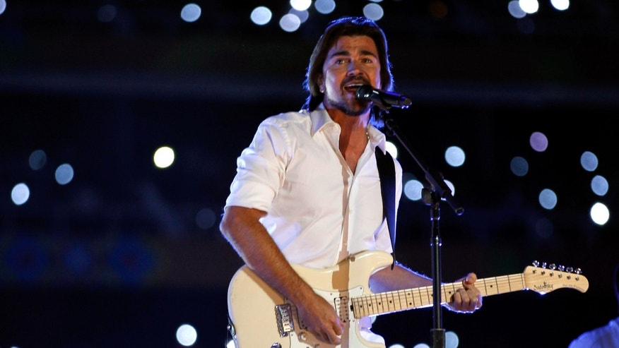Juanes  performs during the Opening Ceremony for the XVI Pan American Games at Omnilife Stadium on October 14, 2011 in Guadalajara, Mexico.