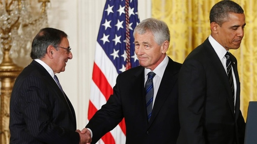 FILE - In this Jan. 7, 2013 file photo, current Defense Secretary Leon Panetta shakes hands with former Nebraska Sen. Chuck Hagel, center, as President Barack Obama moves to the podium during a new conference in the East Room of the White House.
