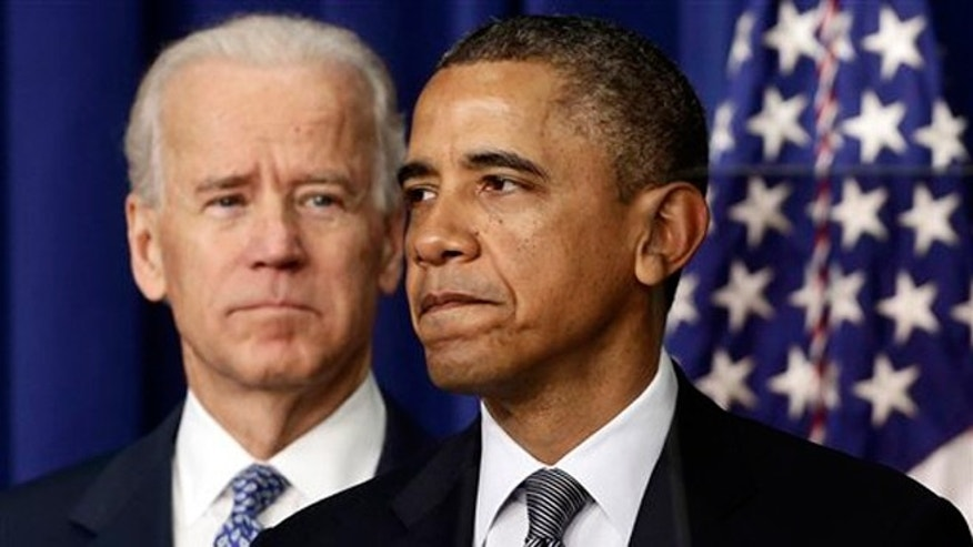 FILE - Jan. 16, 2013:  President Obama, accompanied by Vice President Joe Biden, talks about proposals to reduce gun violence at the White House in Washington.