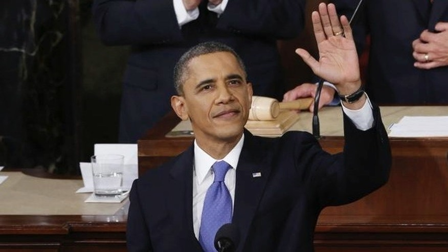 U.S. President Barack Obama waves before delivering his State of the Union Speech on Capitol Hill in Washington, February 12, 2013. REUTERS/Kevin Lamarque (UNITED STATES  - Tags: POLITICS)
