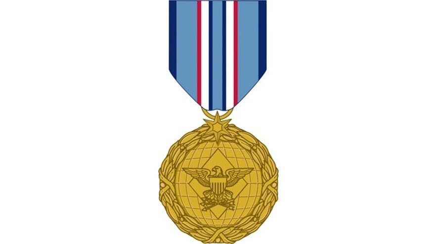 This image released by the Department of Defense shows the obverse view with ribbon of the newly announced Distinguished Warefare Medal.