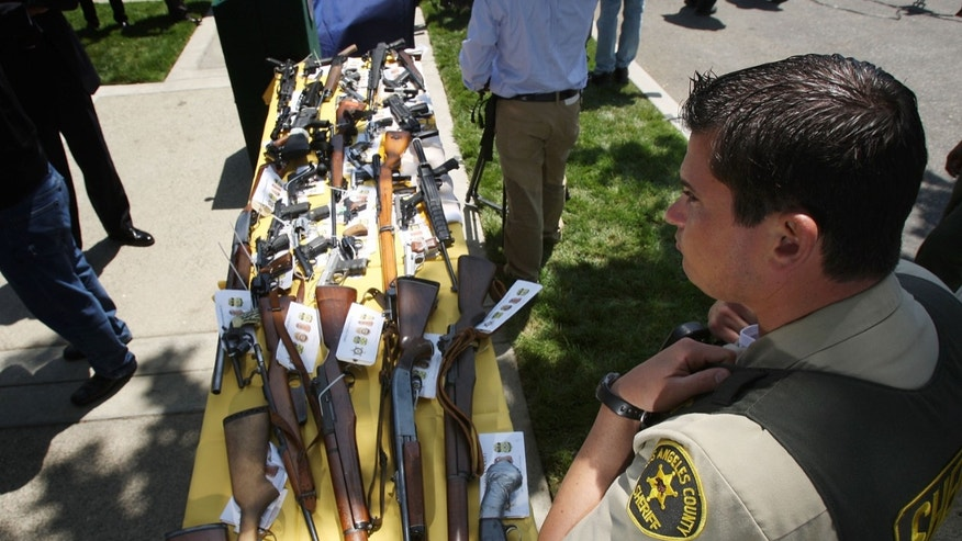LAKEWOOD, CA - MAY 21:  Some of about 125 weapons confiscated during what the federal authorities say is the largest gang takedown in United States history are displayed at a press conference to announce the arrests of scores of alleged gang members and associates on federal racketeering and drug-trafficking charges on May 21, 2009 in the Los Angeles-area community of Lakewood, California. 147 people are indicted in the case involving racially motivated attacks on African-Americans and law enforcement officers. Operation Knockout is the latest of several investigations that found gangs engaged in race-based violence. Two years ago, a Latino gang was charged with waging a violent campaign to drive blacks out of a Los Angeles-area neighborhood that resulted in 20 homicides. Last year, another Latino gang was accused of targeting blacks and killing 14-year-old Cheryl Green, whose death became a community rallying point. In 2006, Avenues gang members Latinos were convicted of assaults and killings of blacks in the 1990s.  (Photo by David McNew/Getty Images)