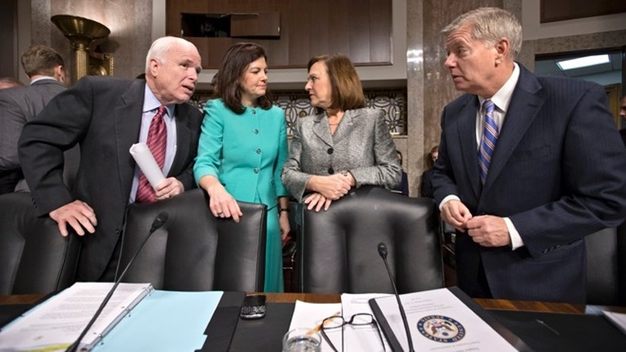 Feb. 12, 2013: Senate Armed Services Committee members, from left, Sen. John McCain, R-Ariz., Sen. Kelly Ayotte, R-N.H., Sen. Deb Fischer, R-Neb., and Sen. Lindsey Graham, R-S.C., gather on Capitol Hill prior to the committee's hearing on the looming cuts to the defense budget that could be part of the sequestration.