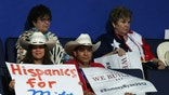 "TAMPA, FL - AUGUST 28:  A woman holds a sign that reads ""Hispanics for Mitt""during the Republican National Convention at the Tampa Bay Times Forum on August 28, 2012 in Tampa, Florida. Today is the first full session of the RNC after the start was delayed due to Tropical Storm Isaac.  (Photo by Mark Wilson/Getty Images)"