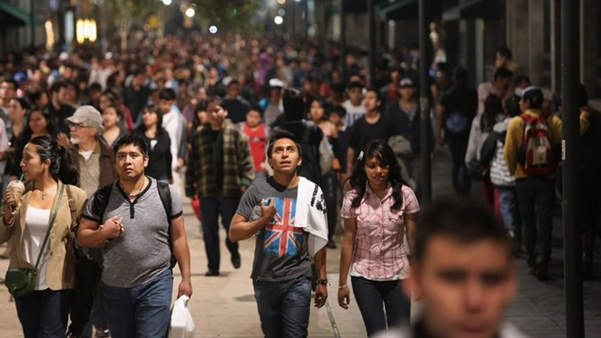 MEXICO CITY, MEXICO - JUNE 23:  Mexican youth walk home after a political demonstration in Mexico City's zocalo square on June 23, 2012 in Mexico City, Mexico. Thousands of Mexican youth, most supporters of leftist presidential candidate Andres Manuel Lopez Obrador, have been demonstrating for a fair electoral process ahead of the July 1 presidential election. Lopez Obrador lost the last presidential election in 2006 by a small margin and never accepted the result, citing fraud. (Photo by John Moore/Getty Images)