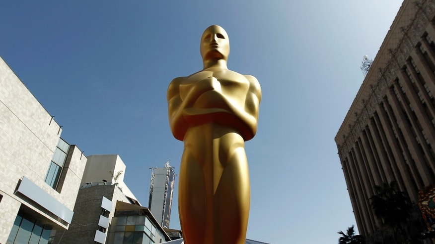 FILE - In this Feb. 26, 2012 file photo, an Oscar statue is seen on the red carpet before the 84th Academy Awards in Los Angeles. The Academy of Motion Picture Arts and Sciences says the golden statuette will visit at least 10 cities as part of its first national tour. Beginning Monday, Feb. 4, 2013, in New York City, the golden guys journey will be chronicled online.  (AP Photo/Matt Sayles, File)