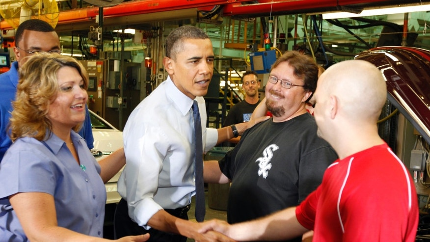 CHICAGO -  AUGUST 5:  U.S. President Barack Obama (3rd L) greets an assembly line workers while touring the Ford Motor Company Chicago Assembly Plant August 5, 2010 in Chicago, Illinois. According to reports, Ford said the plant will add 1.200 new jobs made possible by a Dept. of Energy loan that is intended to help companies retool to make fuel-efficient vehicles.  (Photo by Jeff Haynes/Getty Images)